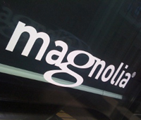 The Magnolia International logo on a building